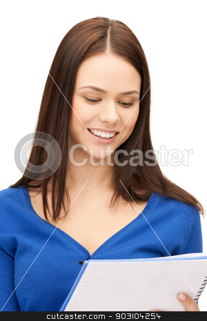 smiling young businesswoman with notebook stock photo, picture of smiling young businesswoman reading notes by Syda Productions
