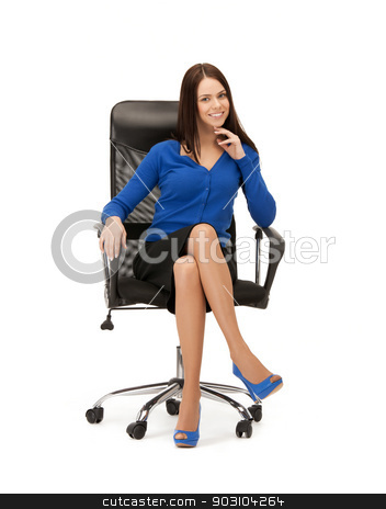 businesswoman sitting in chair stock photo, picture of young businesswoman sitting in chair.. by Syda Productions