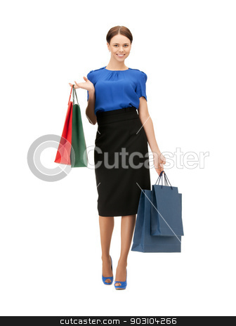 businesswoman with shopping bags on high heels stock photo, portrait of businesswoman with shopping bags on high heels by Syda Productions