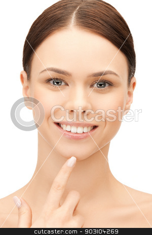 woman touching her chin stock photo, face of beautiful woman touching her chin by Syda Productions
