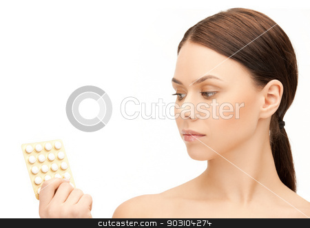 young woman with pills stock photo, picture of sad young woman with pills by Syda Productions