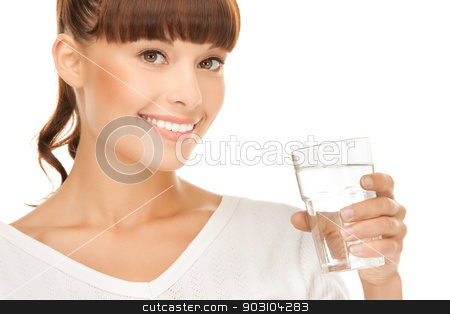 young smiling woman with glass of water stock photo, closeup of young smiling woman with glass of water by Syda Productions