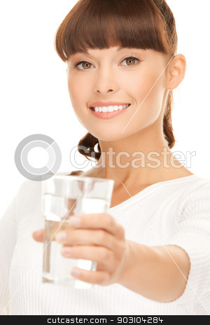 young smiling woman with glass of water stock photo, closeup of young smiling woman offering glass of water by Syda Productions
