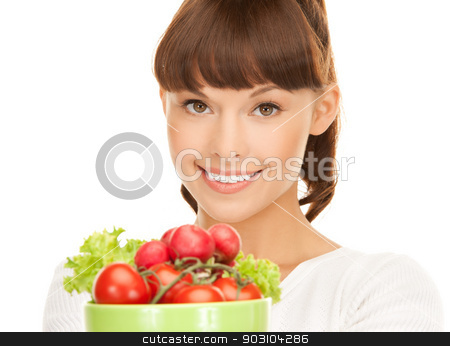 woman in the kitchen with tomatoes stock photo, beautiful woman in the kitchen with tomatoes.. by Syda Productions