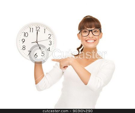 businesswoman pointing her finger at wall clock stock photo, attractive businesswoman pointing her finger at wall clock by Syda Productions