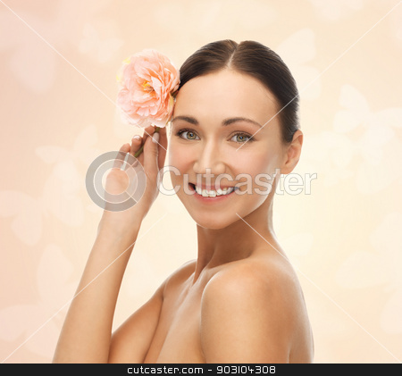 smiling woman with flowers stock photo, bright picture of smiling woman with flower by Syda Productions