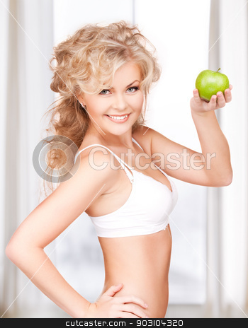 young beautiful woman with green apple stock photo, picture of young beautiful woman with green apple by Syda Productions