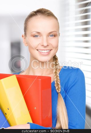 young attractive businesswoman with folders stock photo, picture of a young attractive businesswoman with folders by Syda Productions