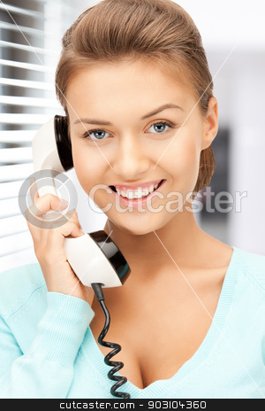 businesswoman with phone stock photo, bright picture of happy businesswoman with phone by Syda Productions