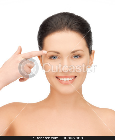woman touching her face skin stock photo, face of beautiful woman pointing at her eyebrow by Syda Productions