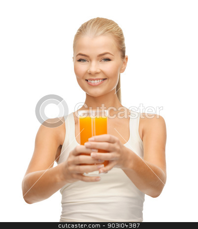 woman holding glass of orange juice stock photo, young woman holding glass of orange juice by Syda Productions