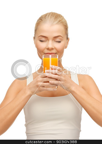 young woman drinking orange juice stock photo, picture of young woman drinking orange juice by Syda Productions