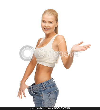 sporty woman showing big pants stock photo, picture of sporty woman showing big pants by Syda Productions