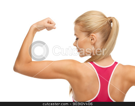 sporty woman showing her biceps stock photo, picture of young sporty woman showing her biceps by Syda Productions