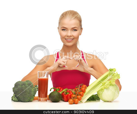woman with organic food stock photo, woman with organic food showing heart shape with hands by Syda Productions