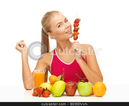 woman with organic food eating strawberry stock photo, young woman with organic food or fruits eating strawberry by Syda Productions