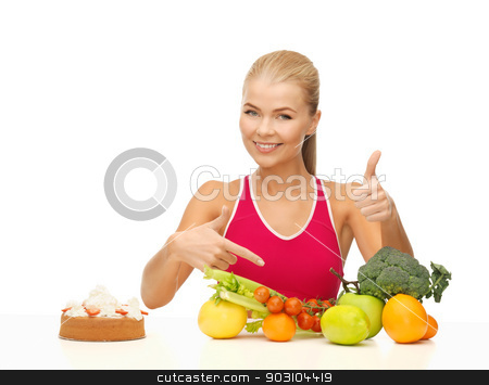 woman pointing at healthy food stock photo, woman with fruits and cake pointing at healthy food by Syda Productions