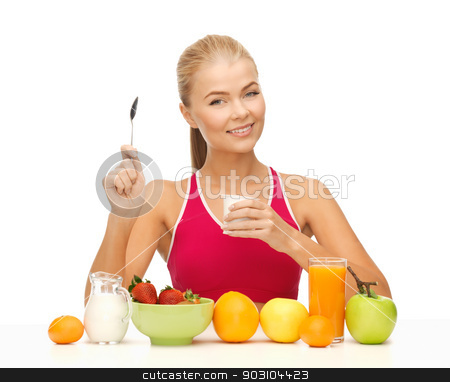 young woman eating healthy breakfast stock photo, picture of young woman eating healthy breakfast by Syda Productions