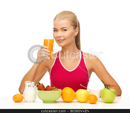 young woman eating healthy breakfast stock photo, young woman with healthy breakfast and drinking orange juice by Syda Productions