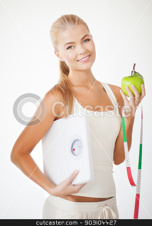 sporty woman with scale, apple and measuring tape stock photo, beautiful sporty woman with scale, green apple and measuring tape by Syda Productions