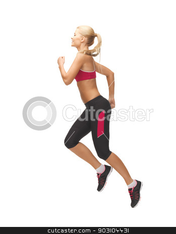 sporty woman running or jumping stock photo, picture of beautiful sporty woman running or jumping by Syda Productions