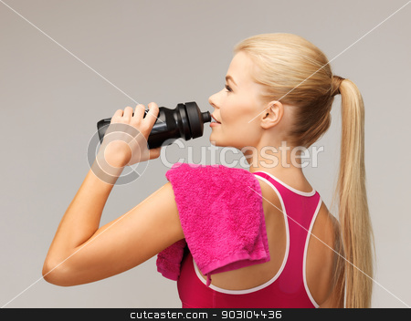 sporty woman drinking water from sportsman bottle stock photo, picture of sporty woman drinking water from sportsman bottle by Syda Productions