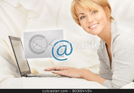 woman with laptop computer sending e-mail stock photo, close up of woman with laptop computer sending e-mail by Syda Productions