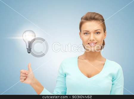 woman with light bulb showing thumbs up stock photo, beautiful woman with light bulb showing thumbs up by Syda Productions