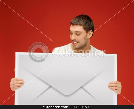 man showing virtual envelope stock photo, picture of handsome man showing virtual envelope by Syda Productions