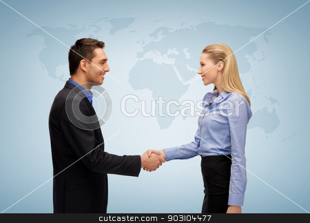 woman and man shaking hands stock photo, picture of businesswoman and businessman shaking hands by Syda Productions