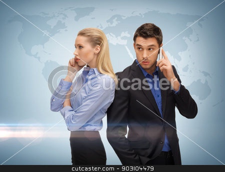 man and woman with cell phones stock photo, picture of man and woman with cell phones by Syda Productions