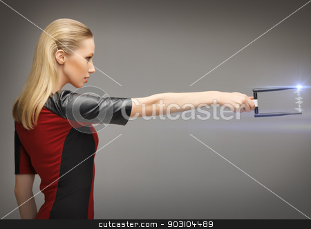 woman with sci fi weapon stock photo, picture of futuristic woman with sci fi weapon by Syda Productions