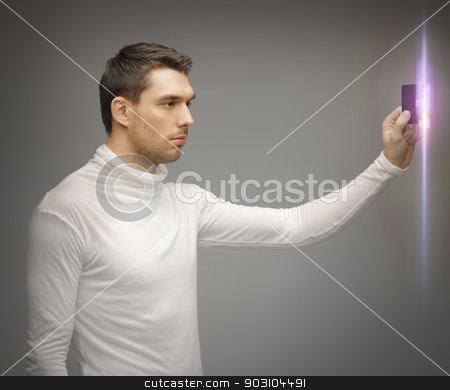 man with access card stock photo, picture of futuristic man with access card by Syda Productions