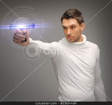 man with sci fi weapon stock photo, picture of futuristic man with sci fi weapon by Syda Productions
