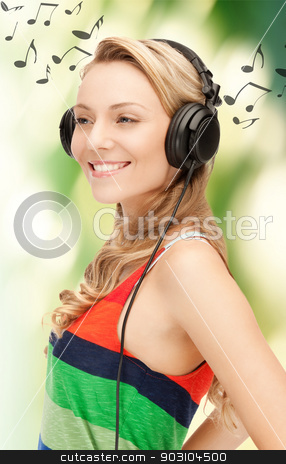woman with headphones stock photo, picture of happy and smiling woman with headphones by Syda Productions