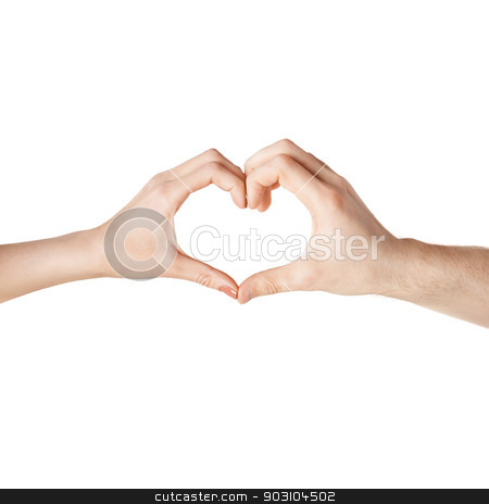woman and man hands showing heart shape stock photo, close-up of woman and man hands showing heart shape by Syda Productions