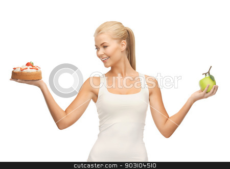 sporty woman with apple and cake stock photo, picture of sporty woman with apple and cake by Syda Productions
