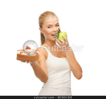 woman eating apple and holding cake stock photo, sporty woman eating apple and holding cake by Syda Productions