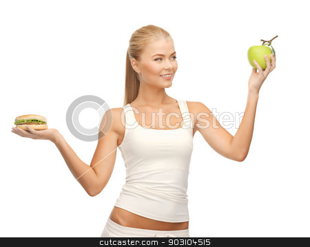 woman with apple and hamburger stock photo, picture of sporty woman with apple and hamburger by Syda Productions