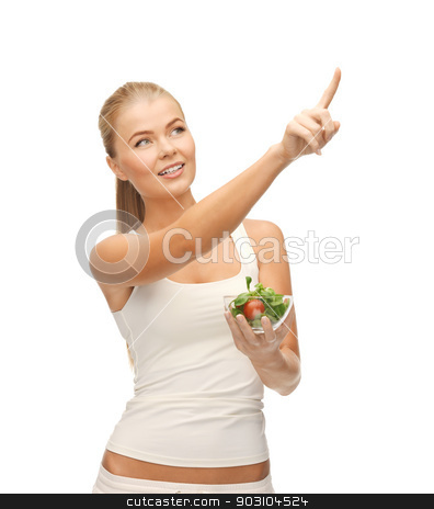 healthy woman holding bowl with salad stock photo, woman with salad pointing her finger at something by Syda Productions