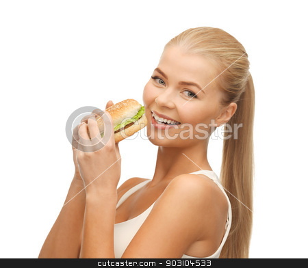 woman eating junk food stock photo, picture of healthy woman eating junk food by Syda Productions