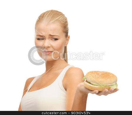 woman rejecting junk food stock photo, picture of healthy woman rejecting junk food by Syda Productions