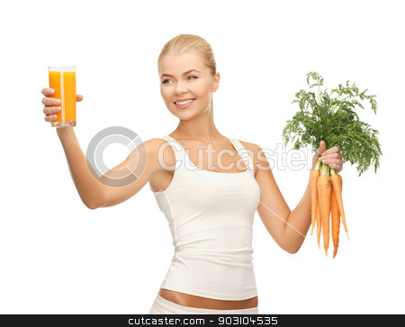 woman holding glass of juice and carrots stock photo, young woman holding glass of juice and carrots by Syda Productions