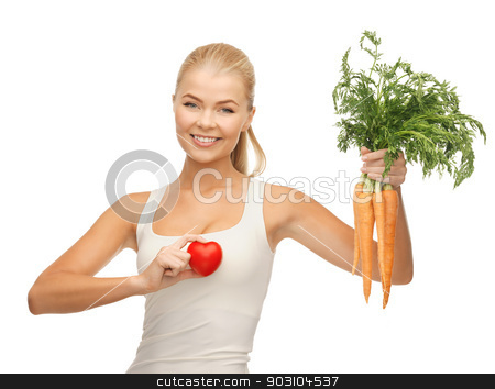 woman holding heart symbol and carrots stock photo, young woman holding heart symbol and carrots by Syda Productions