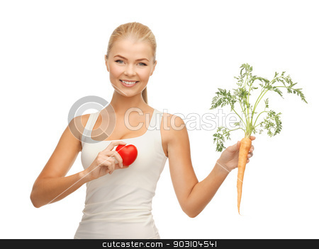 woman holding heart symbol and carrot stock photo, young woman holding heart symbol and carrot by Syda Productions