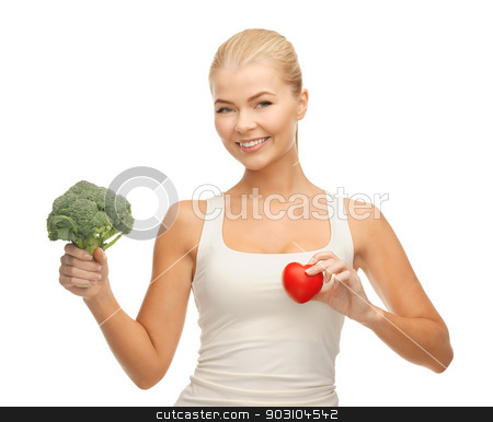 woman holding heart symbol and broccoli stock photo, young woman holding heart symbol and broccoli by Syda Productions