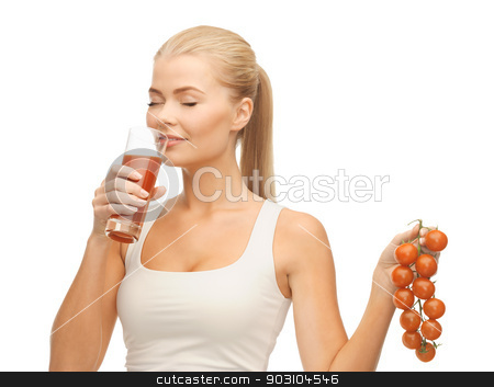 woman drinking tomato juice stock photo, woman drinking tomato juice and holding bunch of tomatoes by Syda Productions