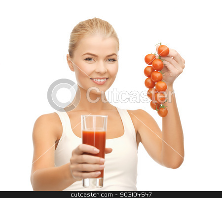 woman holding glass of juice and tomatoes stock photo, young woman holding glass of juice and tomatoes by Syda Productions