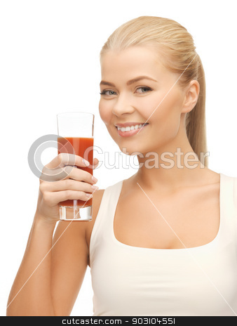 woman holding glass of tomato juice stock photo, young woman holding glass of tomato juice by Syda Productions