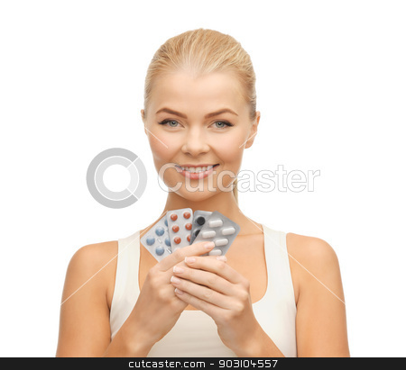 young woman with pills stock photo, picture of young woman with variety of pills by Syda Productions